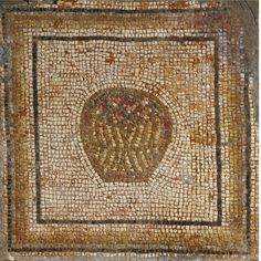 A Byzantine Mosaic Fragment, 5th/6th Century A.D. depicting in multicolored tesserae within a square border a wicker basket of rounded form filled with blossoms(?).   37 by 36 1/2 in. 94 by 92.7 cm.