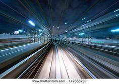 Motion blur of a city and tunnel from inside a moving monorail in Tokyo. - stock photo