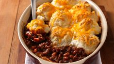Beef, beans and barbecue sauce are topped with biscuits to satisfy hungry cowboy appetites.