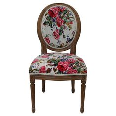 Distressed wood side chair with a round back and floral motif.  Product: ChairConstruction Material: Wood and fabric