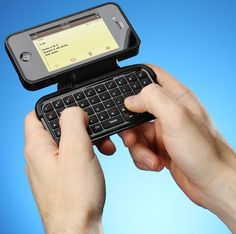 Flip-out mini keyboard case for iPhone -- if only i had an iPhone.. ha