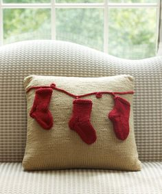 Oh, cute! Knit a pillow with stockings for Christmas. Free downloadable pattern at Red Heart.