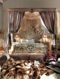 Baroque Royal bedroom ( I just really like that the heavy canopy encloses both the bed and some space around it)