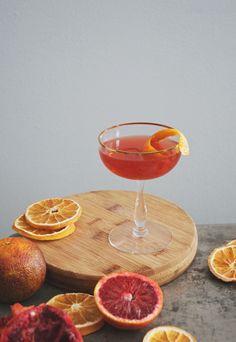 Blood Orange + Fernet Cocktail - Dry Gin, Sweet Vermouth, Blood Orange Juice, Fernet-Branca, Orange Bitters.