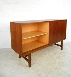 Mid-Century Modern Danish Teak Credenza   From a unique collection of antique and modern credenzas at https://www.1stdibs.com/furniture/storage-case-pieces/credenzas/