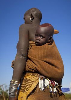 Portrait Of A Bodi Tribe Mother Carrying Her Baby, Hana Mursi, Omo Valley, Ethiopia | Flickr - Photo Sharing!