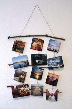 Unsere DIY-Idee für die Winterzeit. Eine Wanddekoration aus Ästen und ausgewählten Fotos. #diy #fotos #do-it-yourself