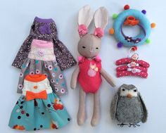 Bunny doll dressing up set, handmade by Plushmito. Muffin the Bunny is is going on holiday to the beach, so she needs to pack her best dresses and swimming costume in her suitcase.