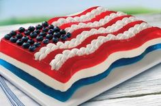 All-American Flag Mold recipe - Chilled in a flag-shaped mold, a COOL WHIP and lemon gelatin mixture separates layers of red and blue gelatin for a special patriotic treat.