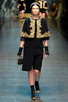 couture: Dolce and Gabbana Fall 2012  A little Old World for today Ornate gold braid adorns black a shawl/ cape