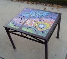 Refurbished Goodwill table, tiled by 5th Graders for their school auction.