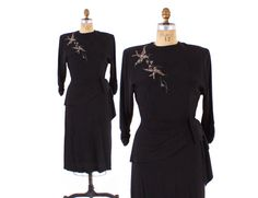 Vintage 40s black rayon crepe cocktail dress. Fabulous silver-cored clear beaded and sequin birds detail at shoulder. The birds are carrying