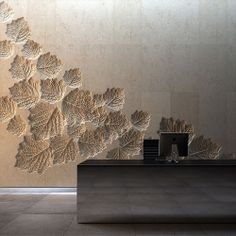 carved stone or plaster impressions of leaves