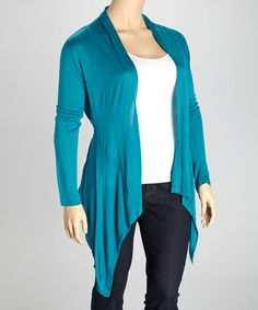 Pull this long-sleeve piece over any ensemble for an added layer that's both pretty and practical. A flowing back panel amps up the style factor while soft fabric stops any shivers.