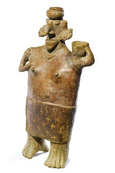 Nayarit, Mexico, Proto-Classic, 100 BC - 250 AD  FEMALE FIGURE CARRYING A BOWL terracotta 48.2 by 30.5cm