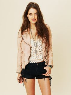 Light pink leather jacket with lace top and black shorts.