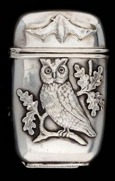Shiebler sterling silver match case or vesta, retailed by Tiffany, with owl and bat motifs on one side, and octopus and fish motifs on the other. c1880