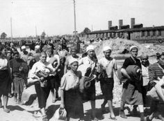 """Birkenau, Poland, Women inside the women's camp. - An album known as """"The Auschwitz Album"""" of photos taken by SS photographers in Auschwitz-Birkenau during the arrival of a transport of Hungarian Jews, 1944."""