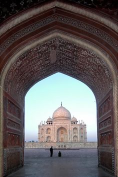 From within the red sandstone pavilion to the East, one can watch the sun's first rays warm the Taj Mahal's stunning white marble.