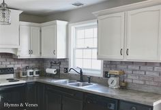 grey kitchen cabinets wall color | Black Kitchen Cabinet Color Idea with Gray Counter, Gray Brick Wall ...