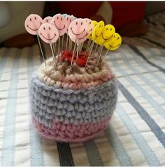 Smiling pins on crocheted pincushion.
