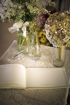 Guest book display at southern wedding. Baby's breath and brooch bouquet in background. See more wedding ideas at mythreeweddings.com