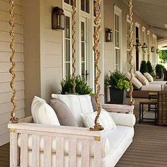 Southern Living - decks/patios - porch swing, porch swing ideas, intellectual gray, taupe paint colors, wall panels, taupe wall panels, taupe paneled walls, swing sofa, sofa swing, swinging sofa,