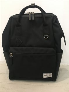 Modern Backpack. Can be used as a tote too. Cool doctors bag opening
