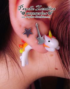 Fire unicorn stud earring fake plug by psychozombies on Etsy, $16.00 the cutest earrings i have EVER seen!!! Wish these were real :c