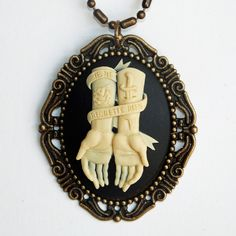 """""""Je Ne Regrette Rien"""" Unique, tattoo inspired cameo featuring adorned, outstretched arms with a banner that tells the world """"I. Cameo Jewelry, Cameo Necklace, Jewelry Box, Jewelery, Unique Jewelry, Necklace Tattoo, Jewelry Tattoo, Hand Jewelry, Black Jewelry"""
