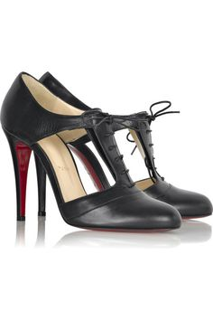 Christian Louboutin's black cutout leather pumps are a chic update on classic lace-up booties.