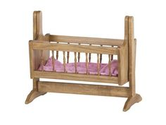 American Made Wooden Swinging Doll Cradle Delightful swinging doll cradle that little ones will enjoy tucking dolly into! Handcrafted with gorgeous spindle work. Finished in choice of stain. #cradle #dollcradle #woodtoys