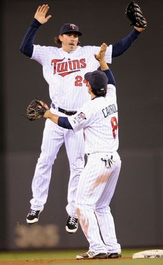 Trevor Plouffe and Jamey Carroll celebrate a win against the Los Angeles Angels on May 8  The Twins defeated the Angels 5-0