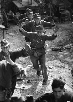 """""""Uneasy group of German soldiers raising their arms in surrender after the US Army 3rd Infantry and 1st Armored Divisions took Cisterna following fierce fighting against elite German units."""", Cisterna, Italy, by George Silk, 1944"""