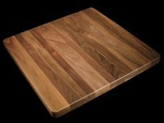 A Natural Finished Random Width Plank Solid Walnut Table