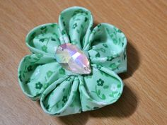 How to Make Fabric Kanzashi Flowers  In this tutorial you'll learn how to make this beautiful Kanzashi fabric flower. It can be attached to a purse, a shirt, a barrette or any other fashion accessory of your choice.