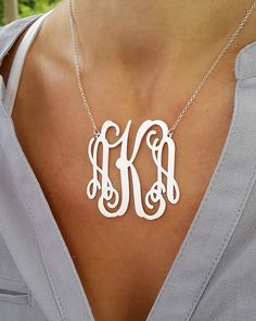 Personalized Monogram necklace, choose 1-3 letters a you wish. Size: This is a 2 wide Thickness: 0.7mm I use 925 Sterling silver for pendant and chain.  Please choose 1-3 letters you like and I will create your unique monogram. It can be your initials, or letters of the one most special to you. *** How to order: ***  1. Choose chain length. 2. At the check-out type into the message to MonogramPersonalized (blank box on order page) 1-3 Letters you would like personalized, I will make the same…