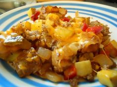 Hearty breakfast scramble of diced, fried potatoes with sausage, peppers and onion, held together with melted cheese!