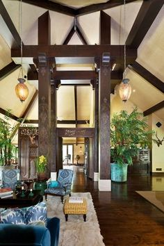 Balinese inspired home in LA - gorgeous teak doors! Love Balinese, Malayan or Japanese designs. It's something about the whole Zenergy of them to me!
