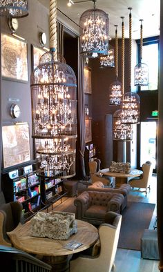 I just want a dozen of these hanging in my livingroom!!! restoration hardware birdcage chandelier -