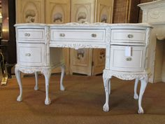 Painted Vintage Mahogany Vanity.    So much charm and detail! Glass knobs, claw and ball feet, mahogany painted white and distressed. $599.00#antique #antiquestore #buckscounty #visitbuckscounty #vintage #decor #shabbychic #shopbuckscounty #countryliving #philly
