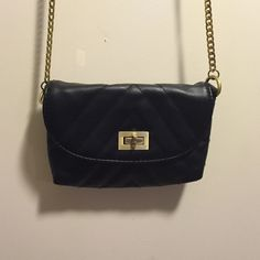 Cute little black purse This cute little black purse has gold colored chain for strap. Perfect for anytime! Fast Shipper❌Sorry No Trades or Paypal❌ Target LIMITED Bags Mini Bags