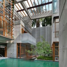 That house makes me want to flood my flat. SHATOTTO Architects designed the amazing SA Residence in Dhaka, Bangladesh. A square basic form made of raw concrete with multi storied buildings, apartments and a water court as swimming pool in the middle of the house  SA Residence by SHATOTTO Architects