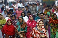 Bangladeshi garment workers arrive for work in Dhaka. The Alliance for Bangladesh Worker Safety said Friday that it had closed or partially closed seven factories over safety concerns.