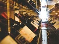 More and more small, upscale wine shops are opening in the city. But will increased competition bottle up profits?
