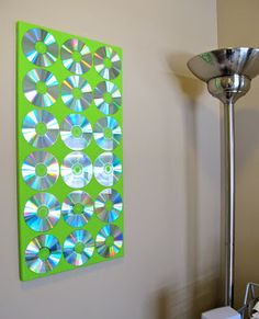 upcycled art CDs glued on painted canvas