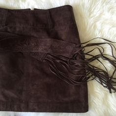 Suede skirt with Fringe belt NWOT The Suede trend is upon us, and this beautiful suede skirt with removal fringe belt is perfect to make your suede fringe statement. NWOT 100% leather and 100% polyester lining. Get it b fore it's gone  zipper back.  ✅Bundle and save ✅ ✅ all reasonable offers will be considered No Trading  Poshmark rules only‼️ Measurements taken laying flat ️️Ⓜ️ waist 15  Ⓜlength 17 INC International Concepts Skirts Mini