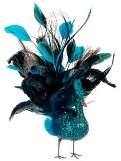 """$12.99-$17.99 From the Regal Peacock Collection Item #BB6780-PC  Peacock's tail features gorgeous natural feathers and brilliant multi-tonal teal feathers Glitter drenched peacock has 2 flexible metal wires attached to its feet for easy and subtle attachment to your holiday decor  Perfect for attaching to your Christmas tree, wreath, garland, floral arrangement or centerpiece  Dimensions: 10""""H x ..."""