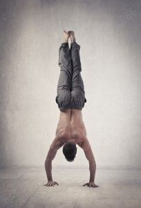 """The ability of the human body to move itself through """"space"""" incredible...handstand push ups are shown here."""