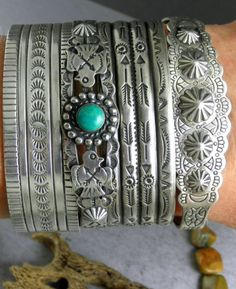I have quite a large collection of Native American jewelry that I have been collecting since I was a child. i LOVE this look and this will be the next look I have to duplicate. Fortunately because I have a child's size wrist, I can usually find child's bracelets at a much cheaper price :))